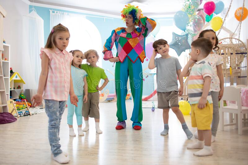 Happy children and clown on birthday party royalty free stock image
