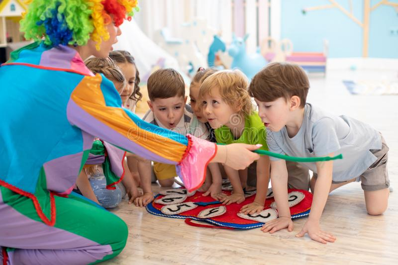 Happy children and clown on party stock photos