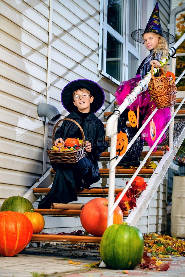 Happy hallowen kids. Happy children in a costumes of witches and wizards celebrating halloween. Trick or treat. Halloween party royalty free stock photo
