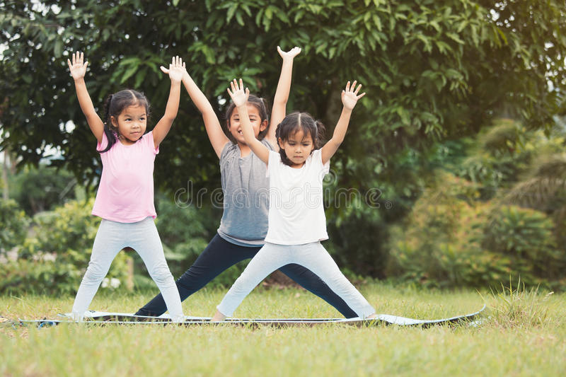 Happy children doing exercise together in outdoor royalty free stock images