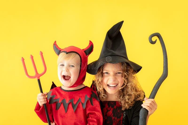 Happy children dressed Halloween costume royalty free stock photos