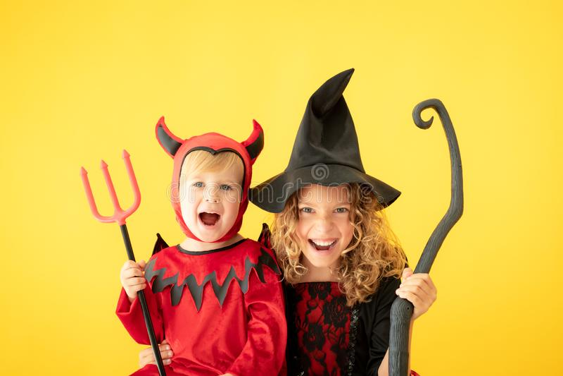 Happy children dressed Halloween costume stock photos