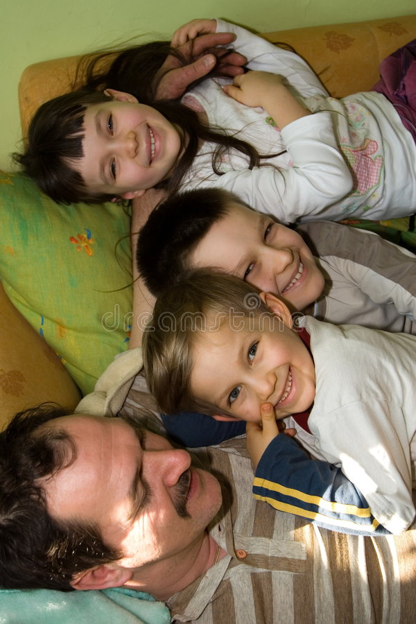 Happy Children With Father stock photo