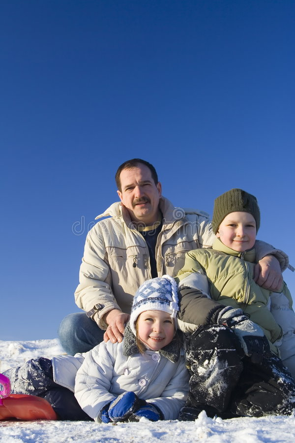 Happy children with father stock images