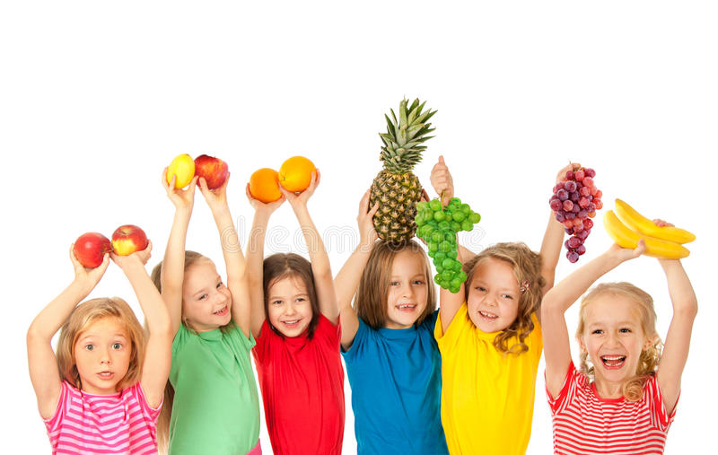 Happy children with fruits stock photos