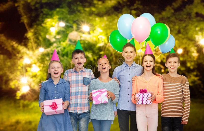 Happy children with gifts at birthday party stock photo