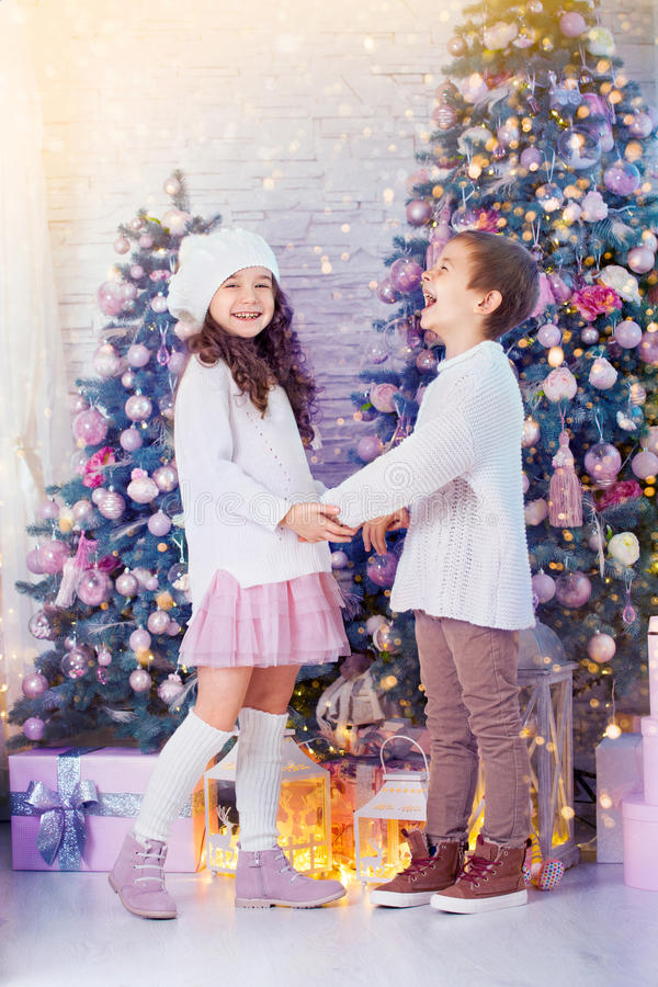 Happy children girl and boy waiting for Christmas, winter holidays stock photography