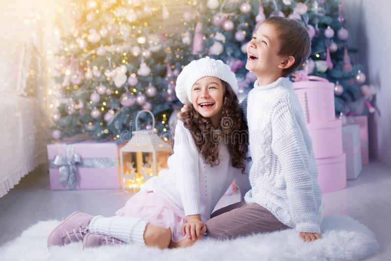 Happy children girl and boy waiting for Christmas, winter holidays royalty free stock photos