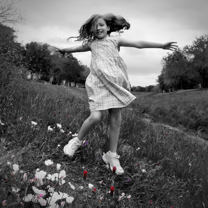 Happy children girl jumping on spring poppy flowers royalty free stock photography