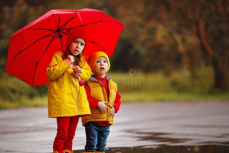 Happy children girl with umbrella on autumn walk royalty free stock photography