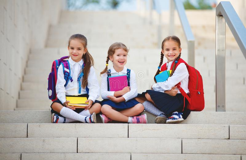 Happy children girlfriend schoolgirl student elementary school royalty free stock photo