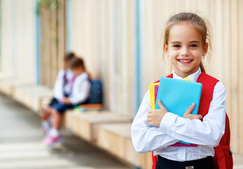 Happy children girlfriend schoolgirl student elementary school stock photo