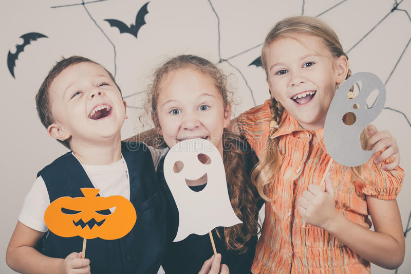 Happy children on Halloween party. Happy brother and two sisters on Halloween party royalty free stock photography