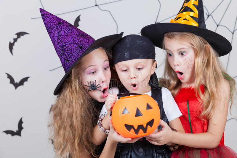 Happy children on Halloween party. Happy brother and two sisters on Halloween party royalty free stock photo