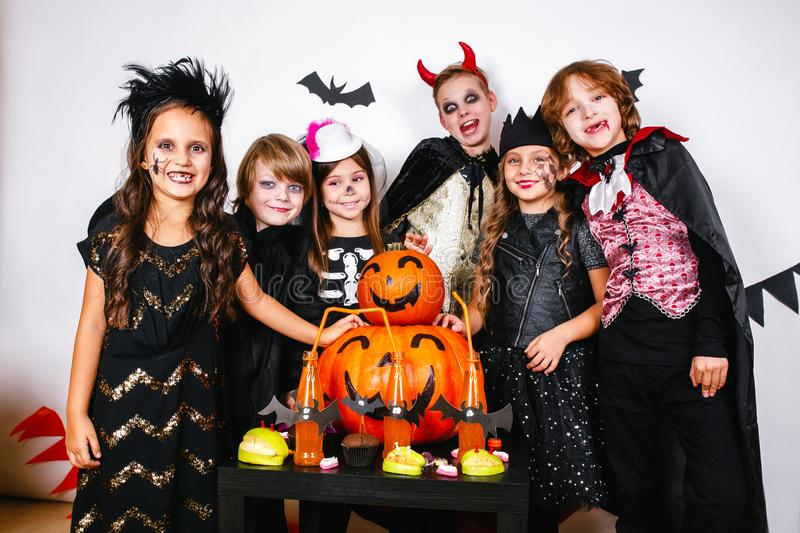 Happy brothers and two sisters on Halloween party stock images