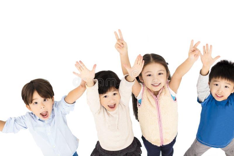 happy children with hands up stock photos
