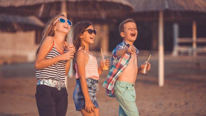 Happy children having fun on the beach royalty free stock photography