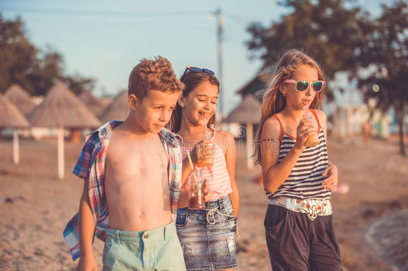 Happy children while having fun on the beach stock images