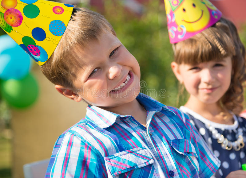 Happy children having fun at birthday party. Two happy children having fun at birthday party stock image