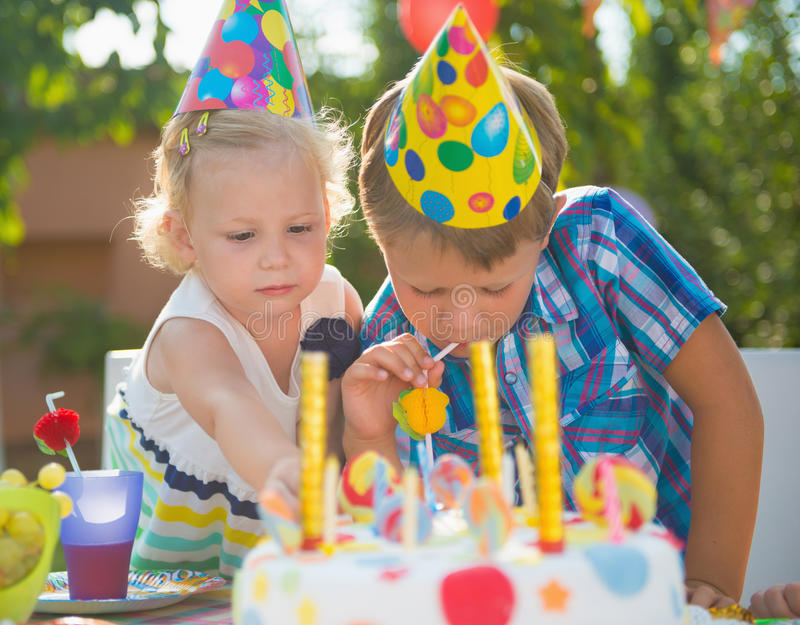 Happy children having fun at birthday party. Two happy children having fun at birthday party stock photo