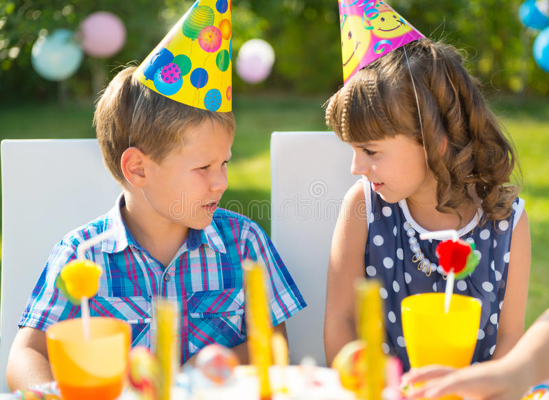 Happy children having fun at birthday party. Two happy children having fun at birthday party stock images