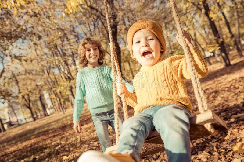 Happy children having fun outdoor in autumn park stock photo