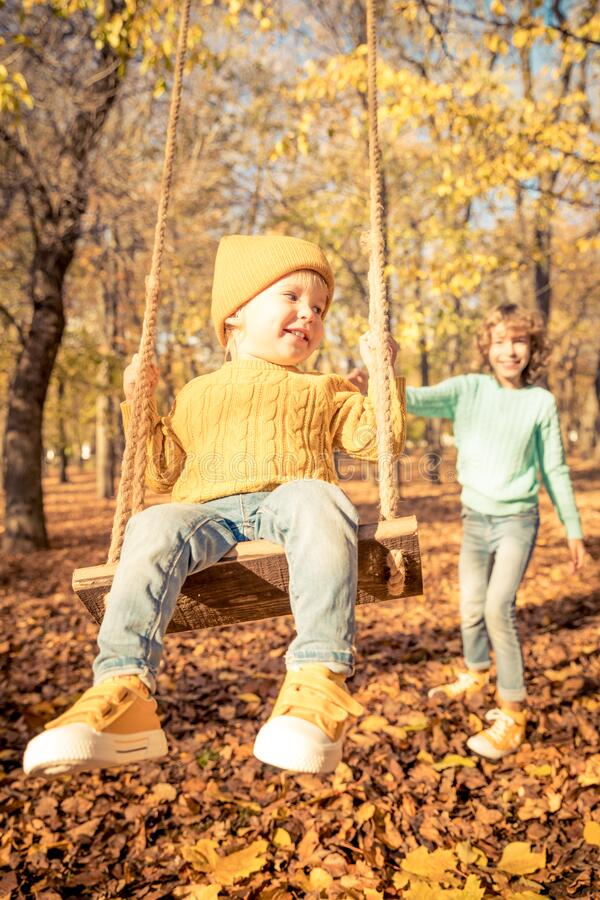 Happy children having fun outdoor in autumn park royalty free stock photos
