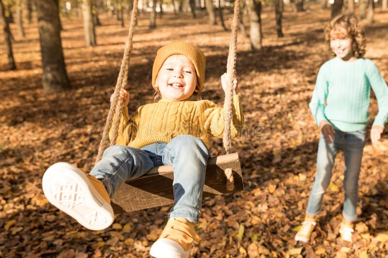 Happy children having fun outdoor in autumn park royalty free stock images