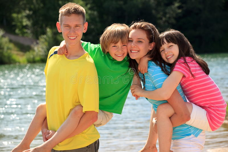 Happy children by lake stock images