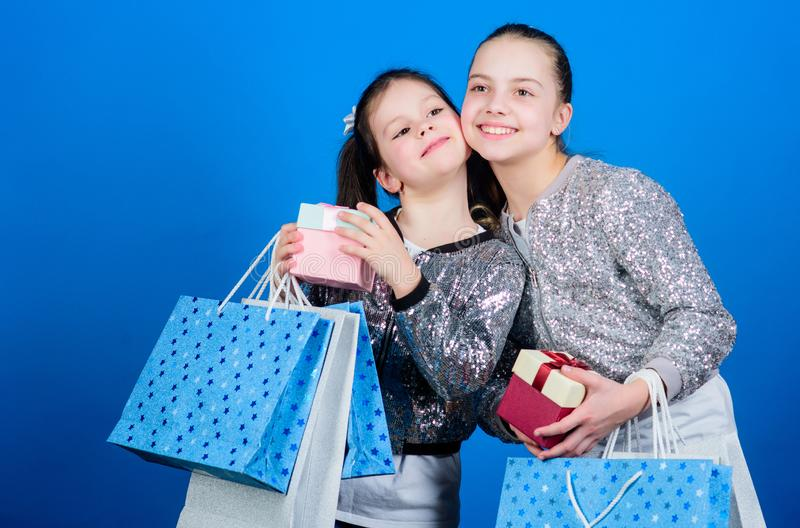 Happy children. Little girl sisters with gift box. Small girls with shopping bags. Sales and discounts. Sisterhood stock image