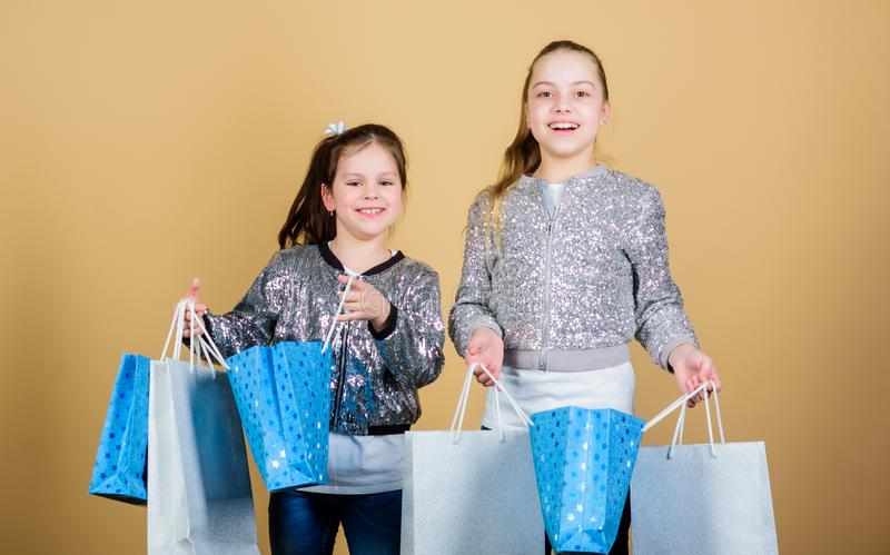Happy children. Little girl sisters online shopping. Sales and discounts. Sisterhood and family. savings on purchases. Kid fashion. shop assistant with package stock image