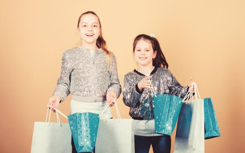 Happy children. Little girl sisters online shopping. Sales and discounts. Sisterhood and family. savings on purchases. Kid fashion. shop assistant with package royalty free stock photos
