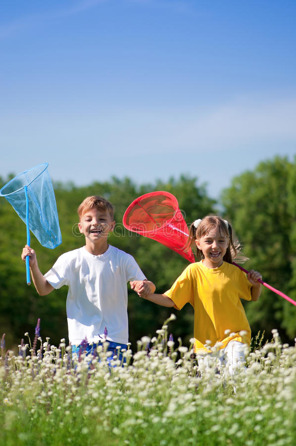 Download Happy children on meadow stock photo. Image of natural - 26906446