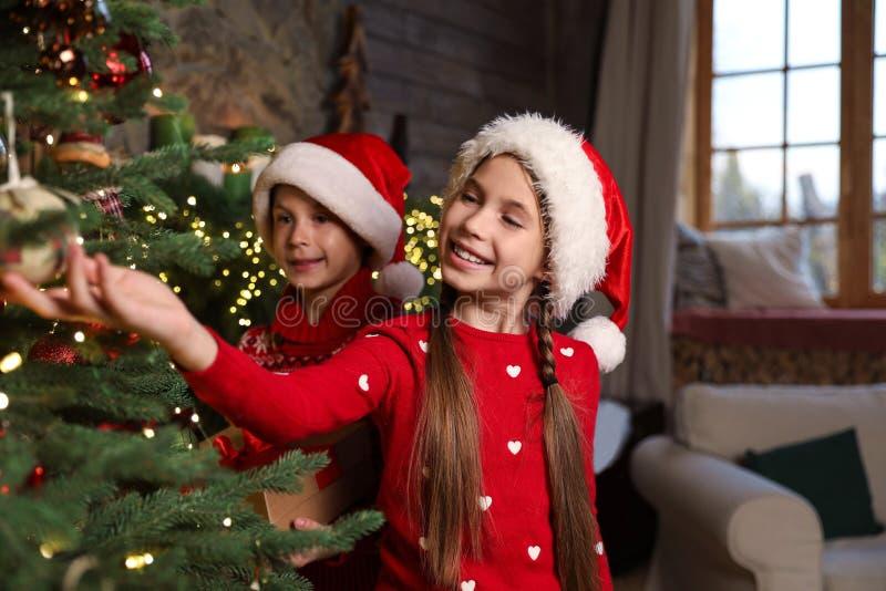 Happy children near beautiful Christmas tree royalty free stock photos