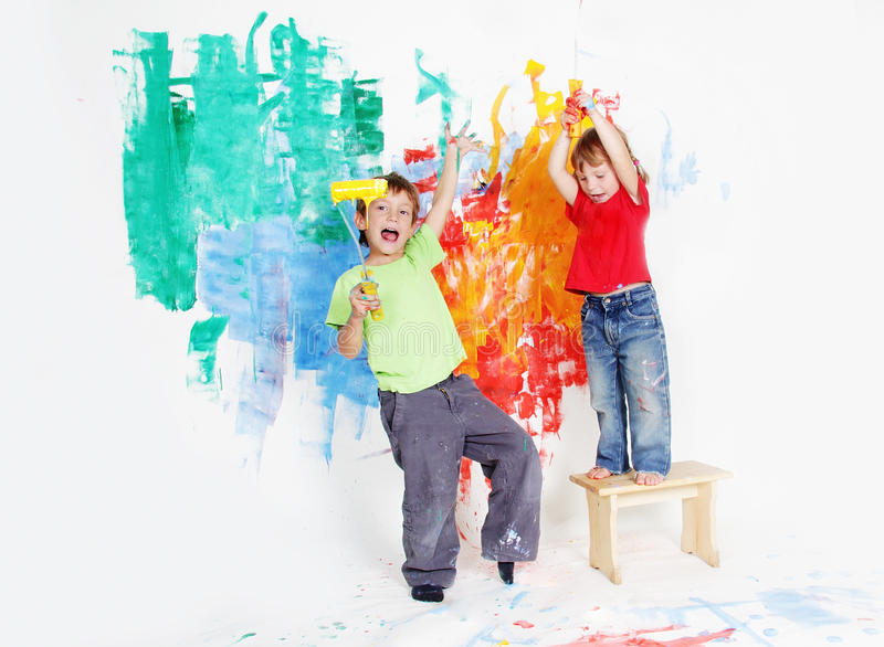 Happy Children Painting Wall With Colours Stock Image - Image of ...