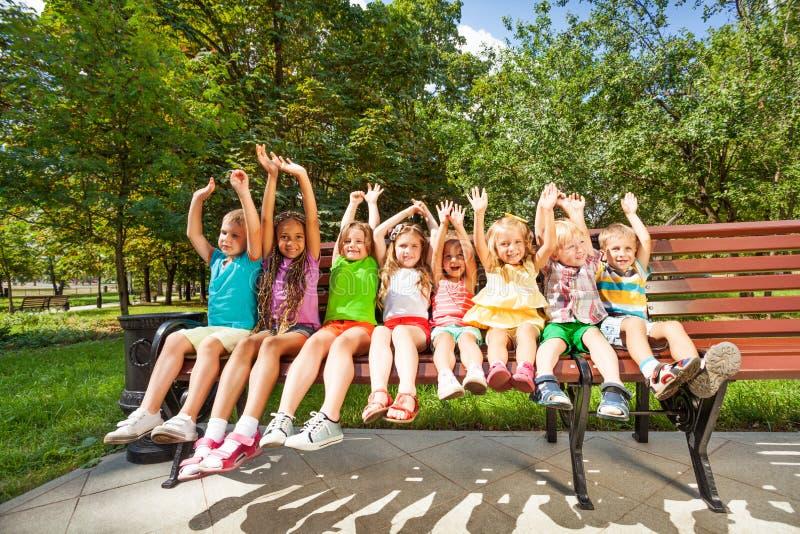 Happy children in park bench stock photography