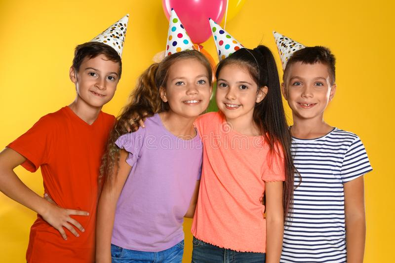 Happy children in party hats. Birthday celebration stock photos