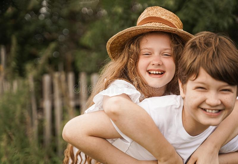 Happy children with piggyback riding in sunset light stock images