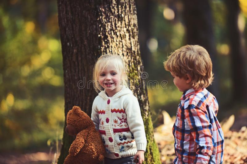 Happy children play in autumn forest. Happy family, friendship, love and trust.  royalty free stock photos