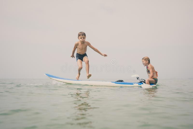 Happy children playing on the beach at the day time royalty free stock photos