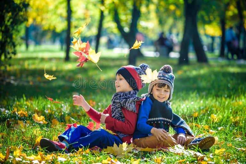 Happy children playing in beautiful autumn park on warm sunny fa stock photography