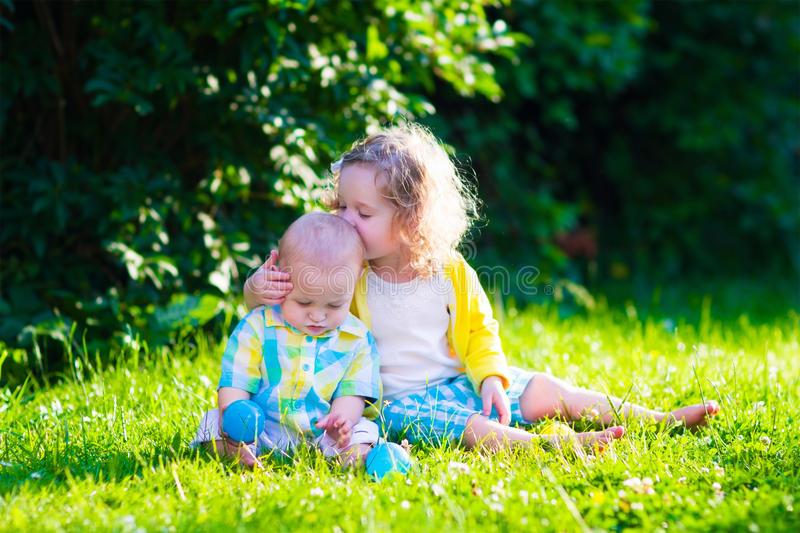 Happy children playing in the garden with toy balls royalty free stock image