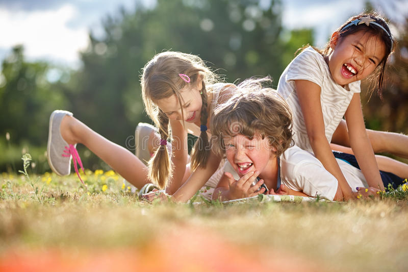 Happy children playing and having fun. In summer stock image