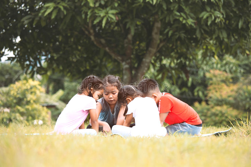 Happy children playing and having fun together in outdoor. In summer time stock images