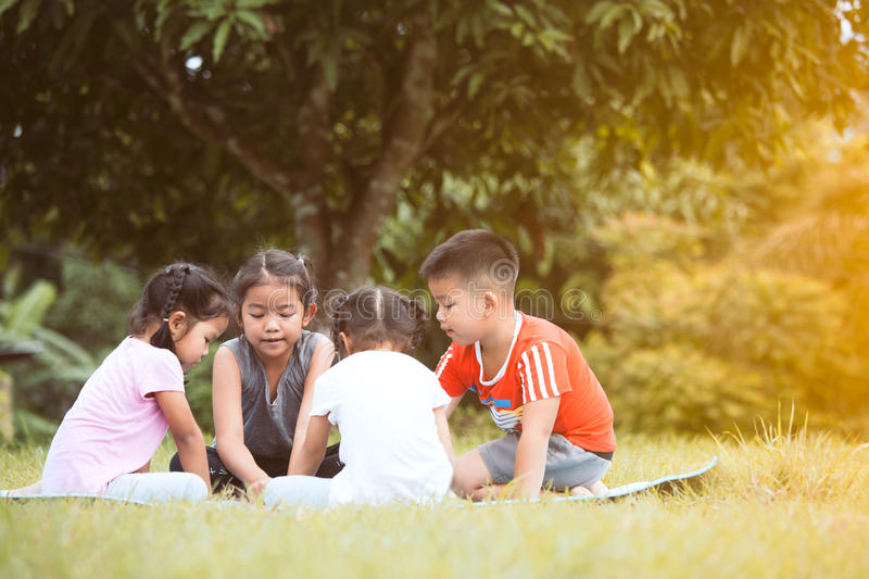 Happy children playing and having fun together in outdoor. In summer time royalty free stock photography
