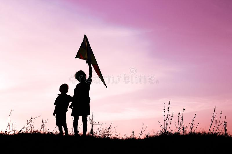 Happy children playing on nature summer silhouette. Very Happy children playing on nature summer silhouette royalty free stock photos