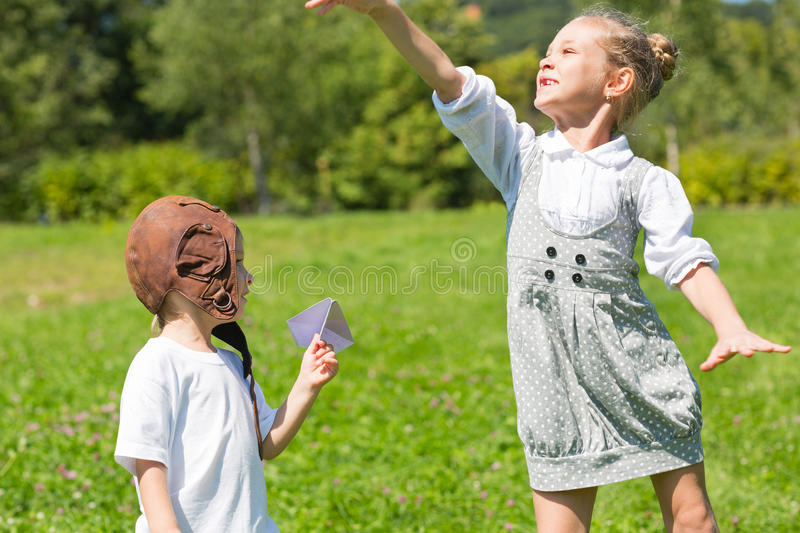 Happy children playing in the paper plane royalty free stock photography