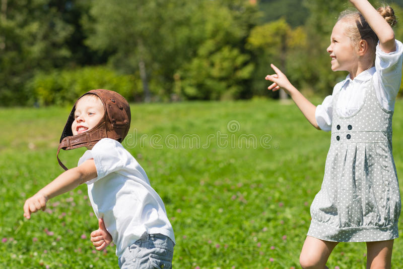 Happy children playing in the paper plane stock photos