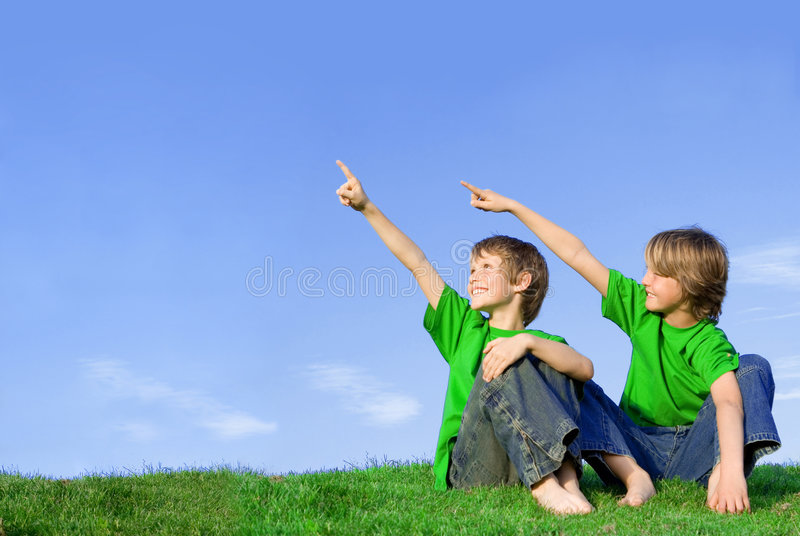 Happy children pointing stock photography
