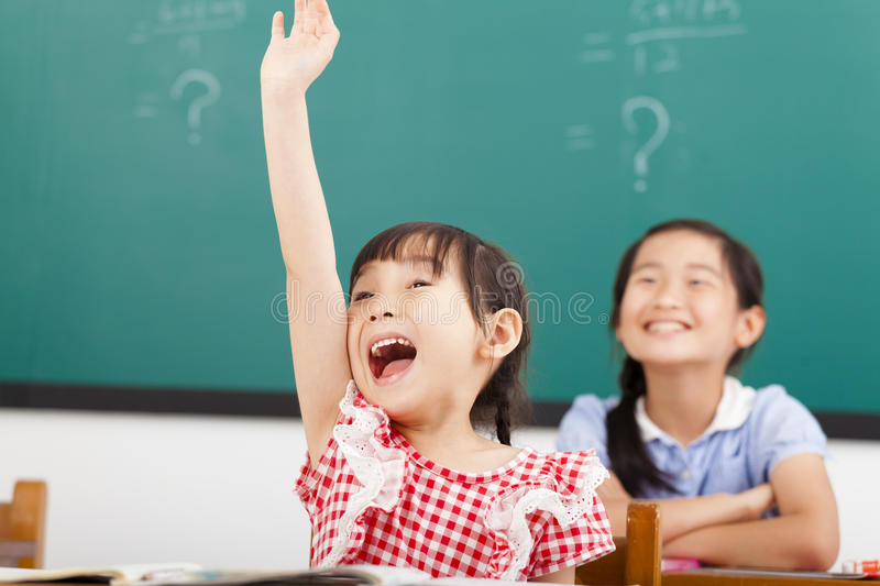Happy children raised hands in class royalty free stock photo